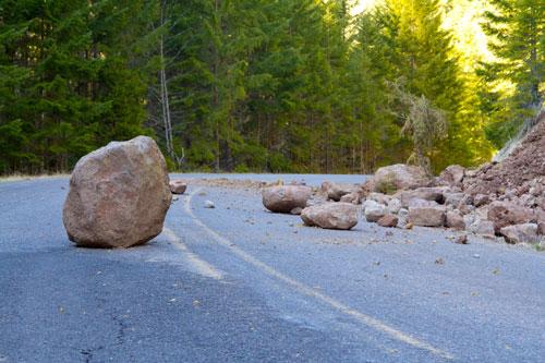 boulders blocking mountain road